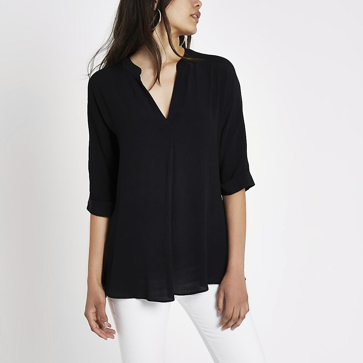 Black short sleeve twist back blouse