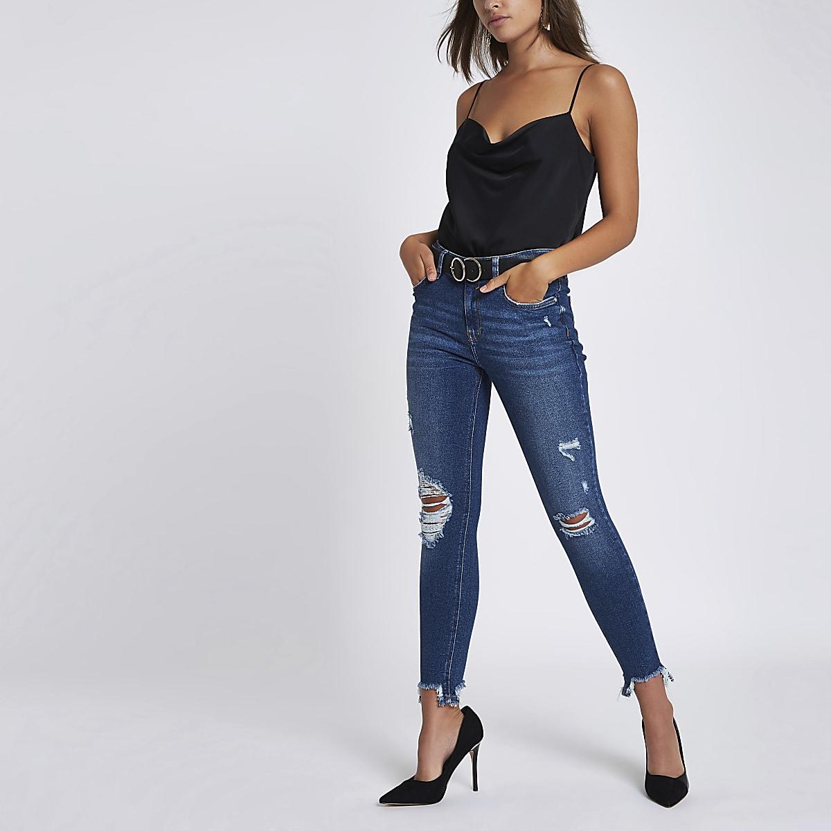1655e3f9ade124 Amelie - Blauwe ripped skinny jeans met gerafelde zoom - Skinny ...