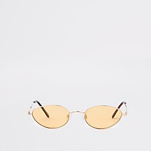 Sonnenbrille mit schmalem, ovalem Gestell in Gold