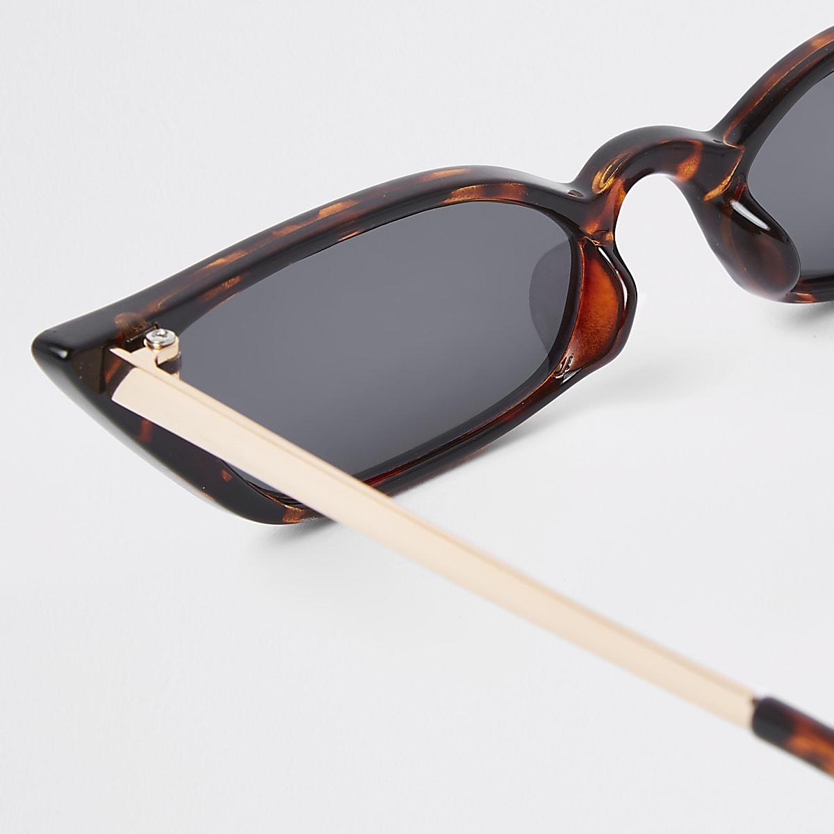 b79efac5fb6922 Bruine tortoise zonnebril met smal visor - Cat-eye-zonnebrillen ...