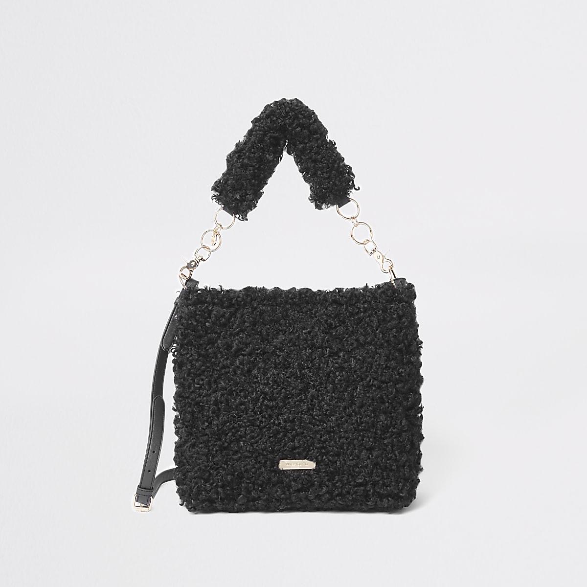 Zwarte ruime tas met textuur en borg