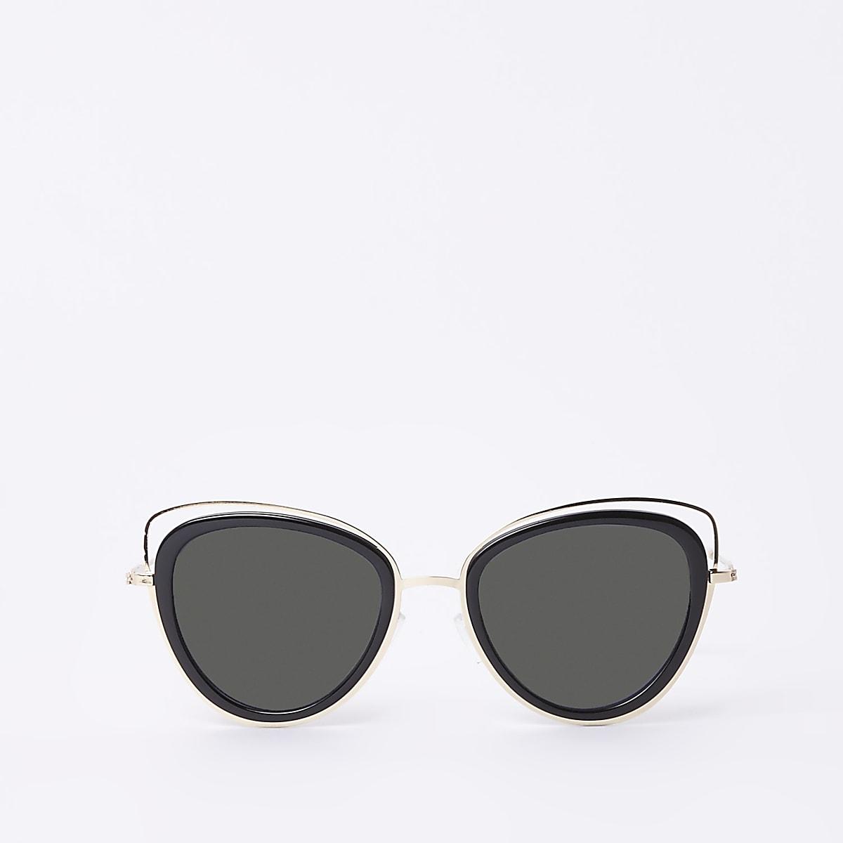 Goudkleurige cat-eye-zonnebril met uitsnede