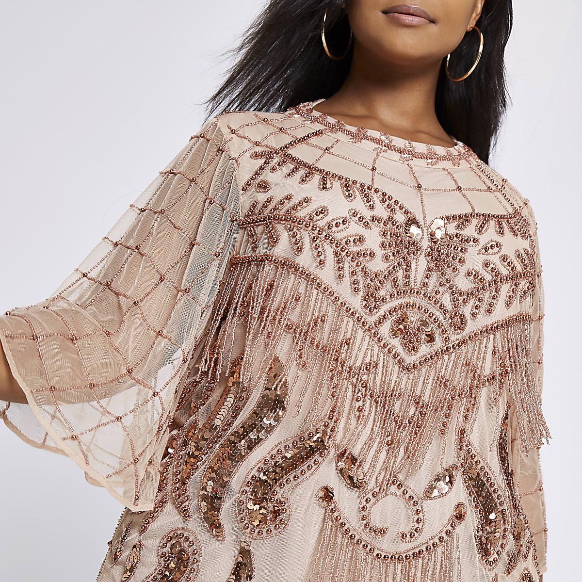 Plus pink embellished blouse