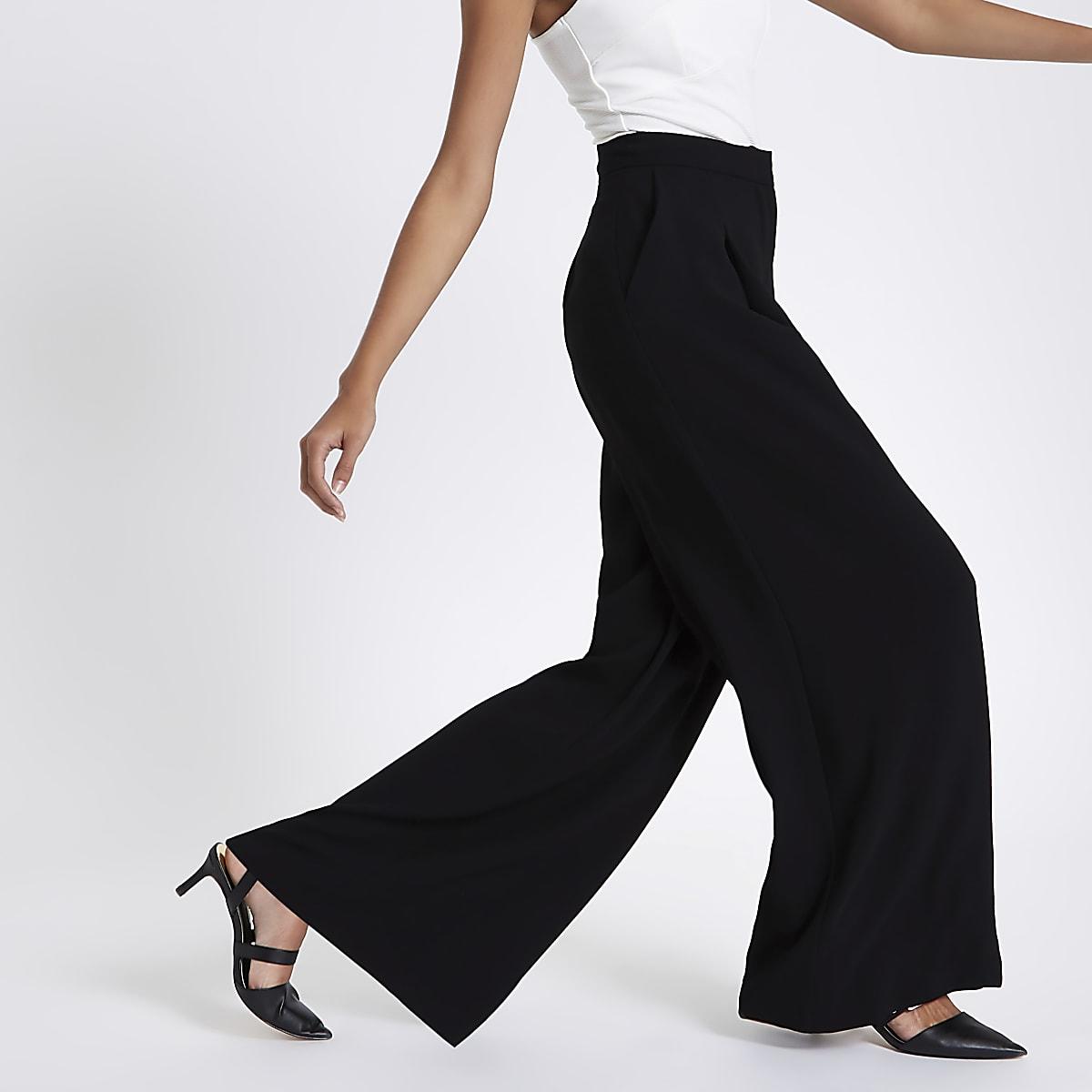 Zwarte broek met wijde pijpen en hoge taille