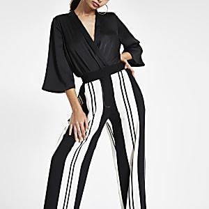 Zwarte broek met wijde pijpen en contrasterende streep