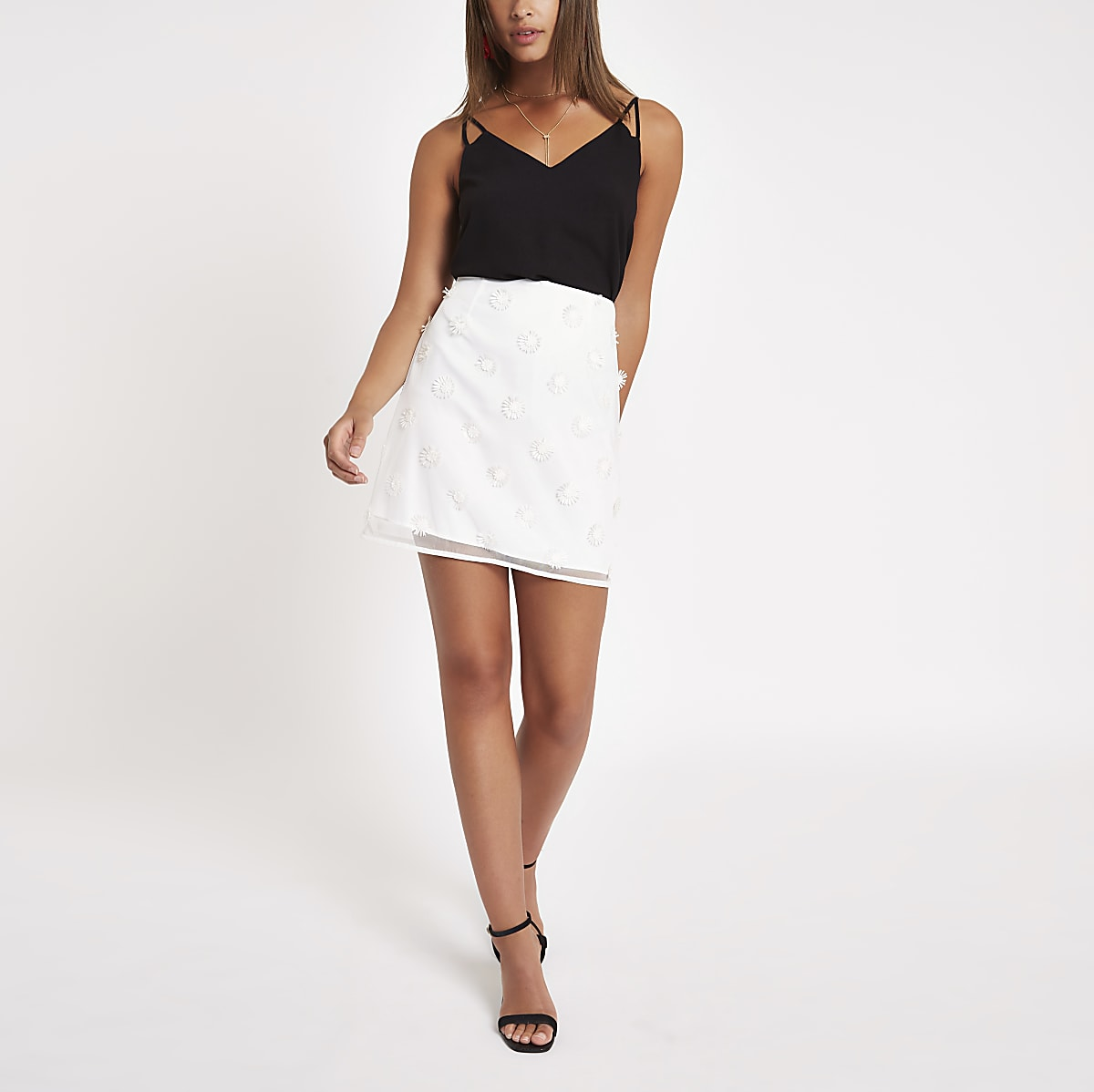 White flower embellished mini skirt
