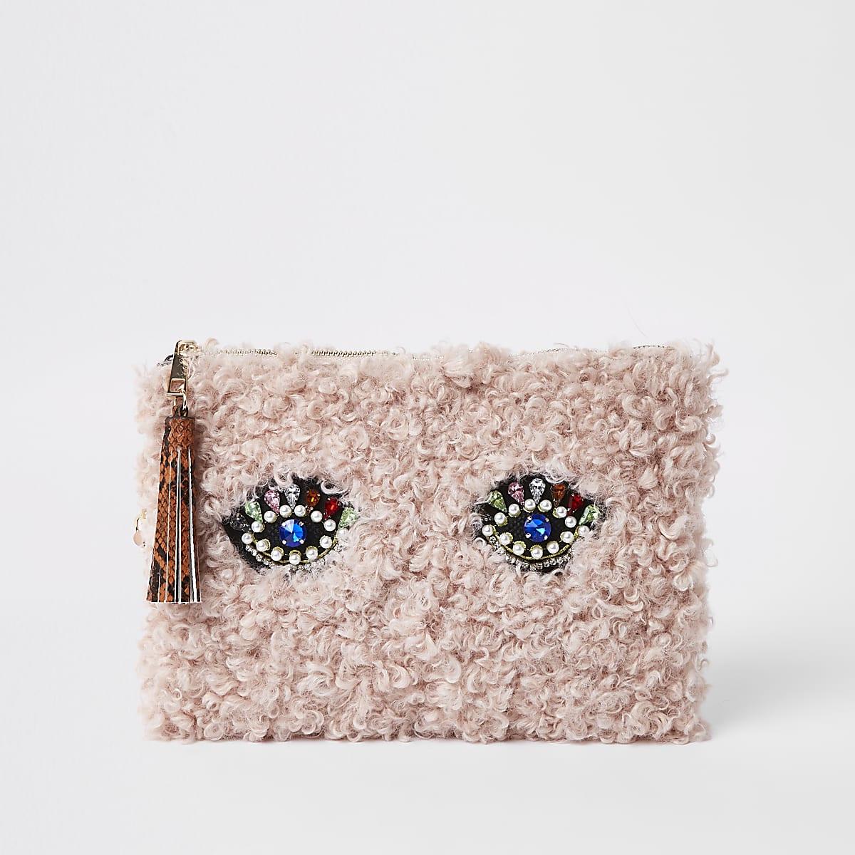 Light pink borg embellished eye clutch bag