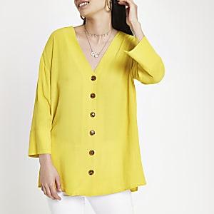 Gele blouse met knoopsluiting en band achter