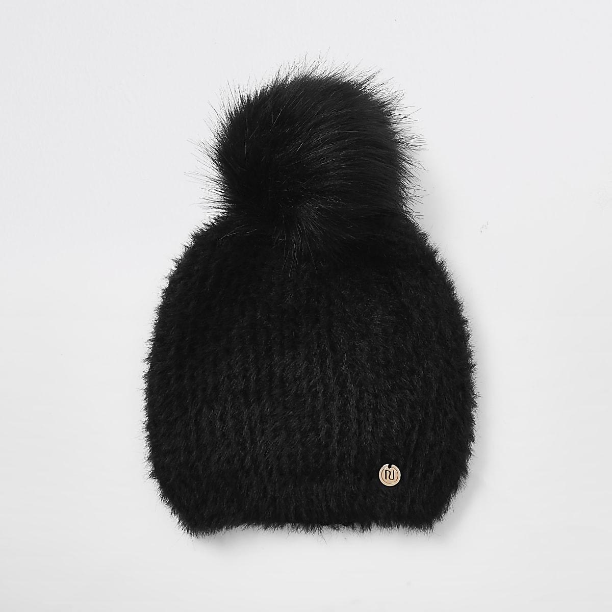 Zwarte beanie met imitatiebont en pompons