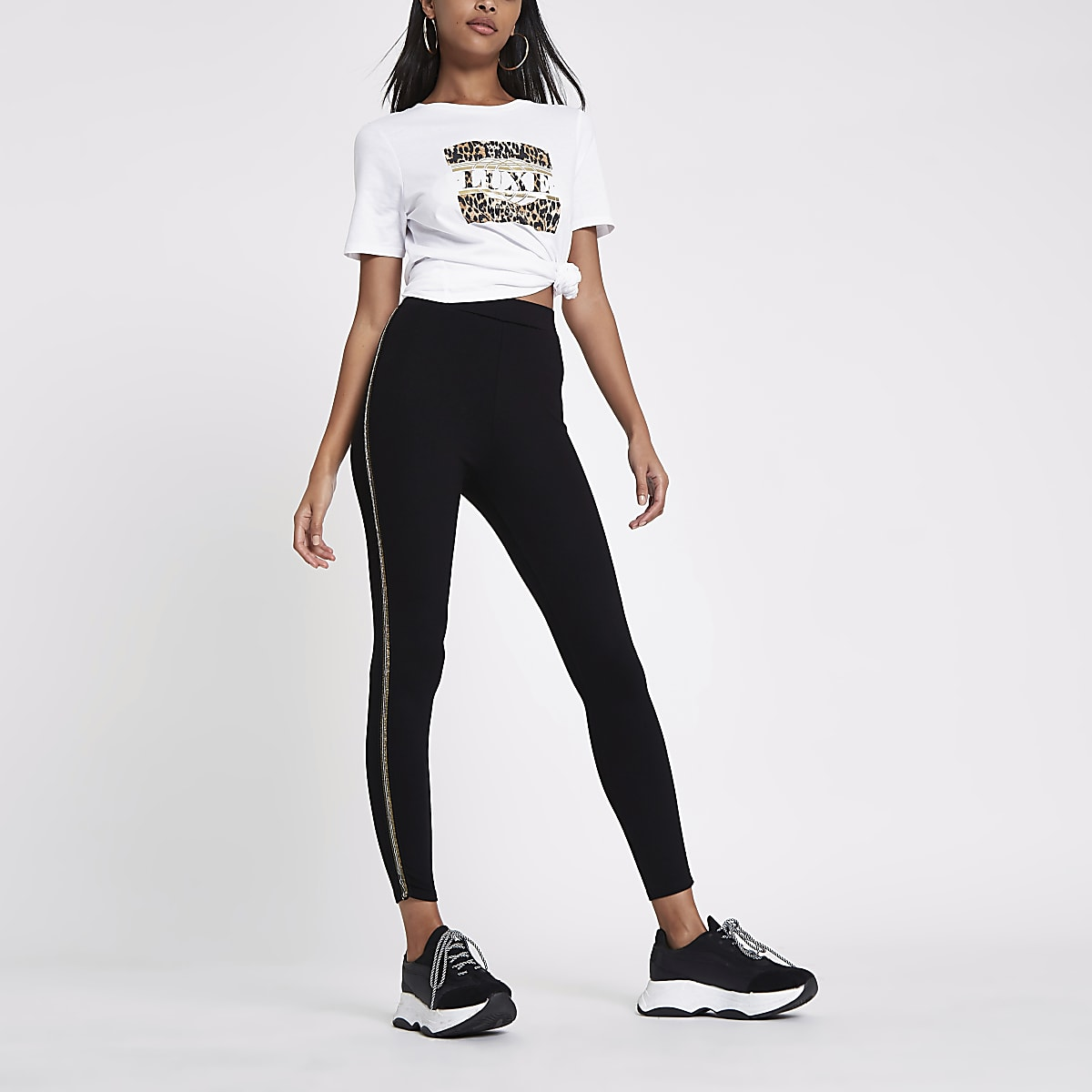 Zwarte legging met pailletten en streep opzij