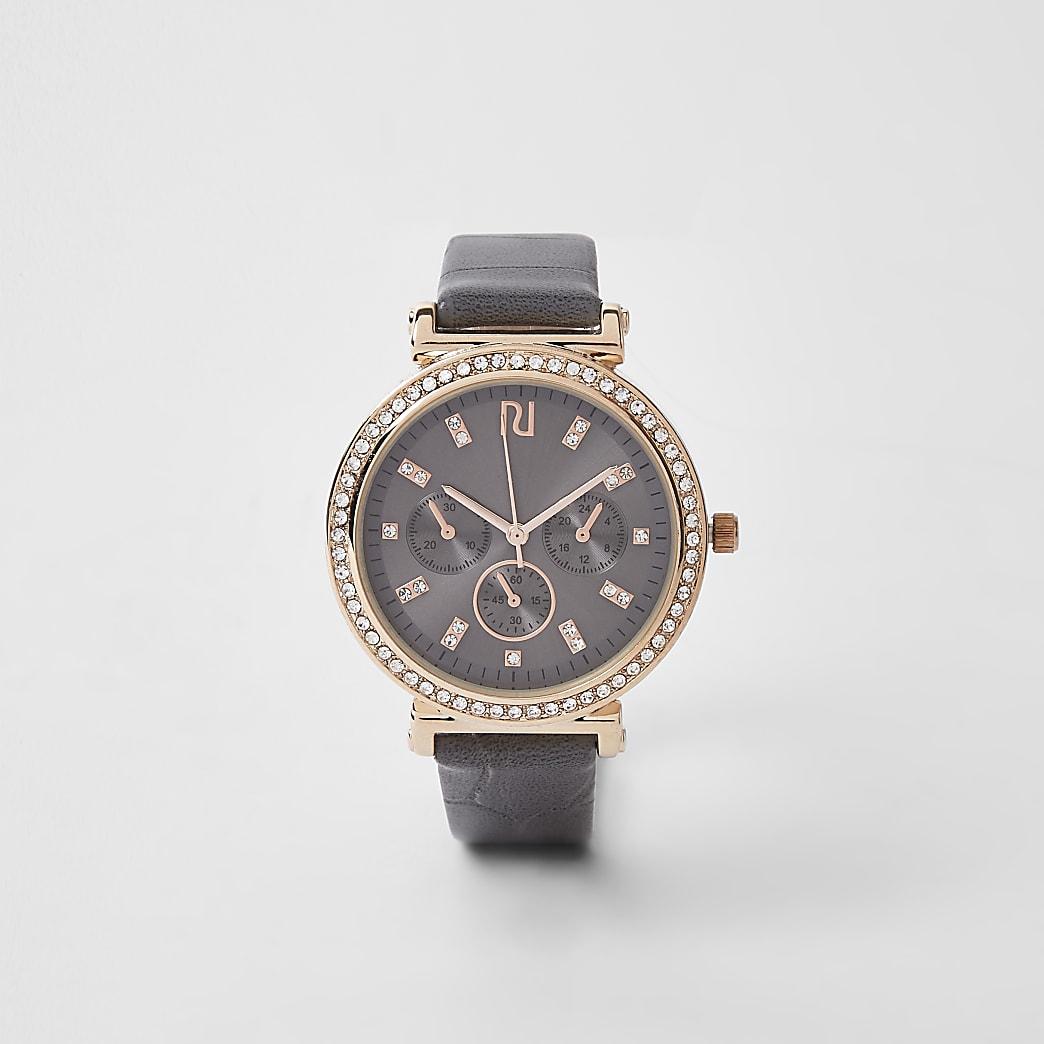 Donkergrijs met goudkleurig horloge met diamantjes en krokodillenprint in reliëf