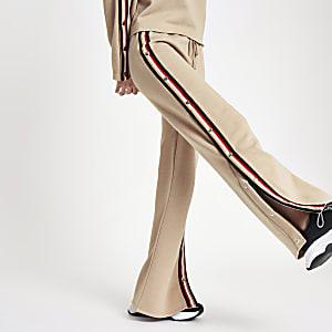 Pantalon de jogging large beige avec boutons-pression
