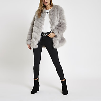 Grey faux fur chevron panelled coat