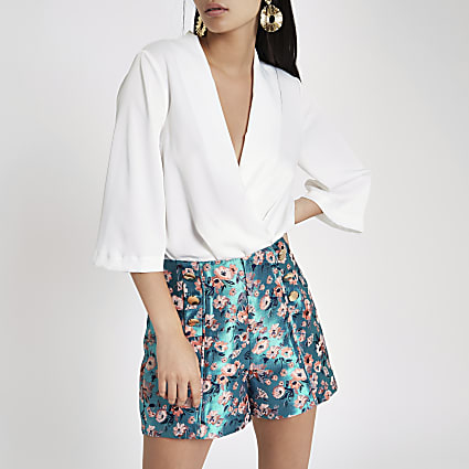 Blue floral jacquard button front shorts
