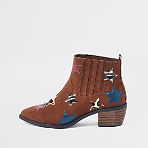Brown star print block heel ankle boots