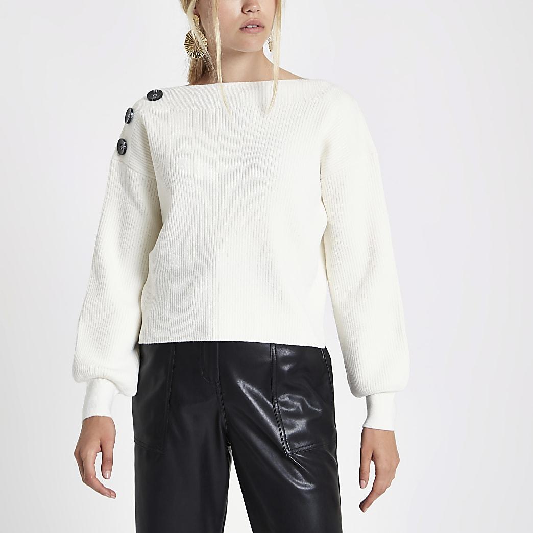 Crème geribbelde gebreide pullover met knopen op de schouder