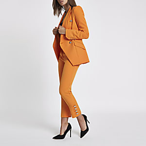 Orange gold tone button cigarette trousers