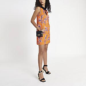Robe à fleurs orange avec nœud au col