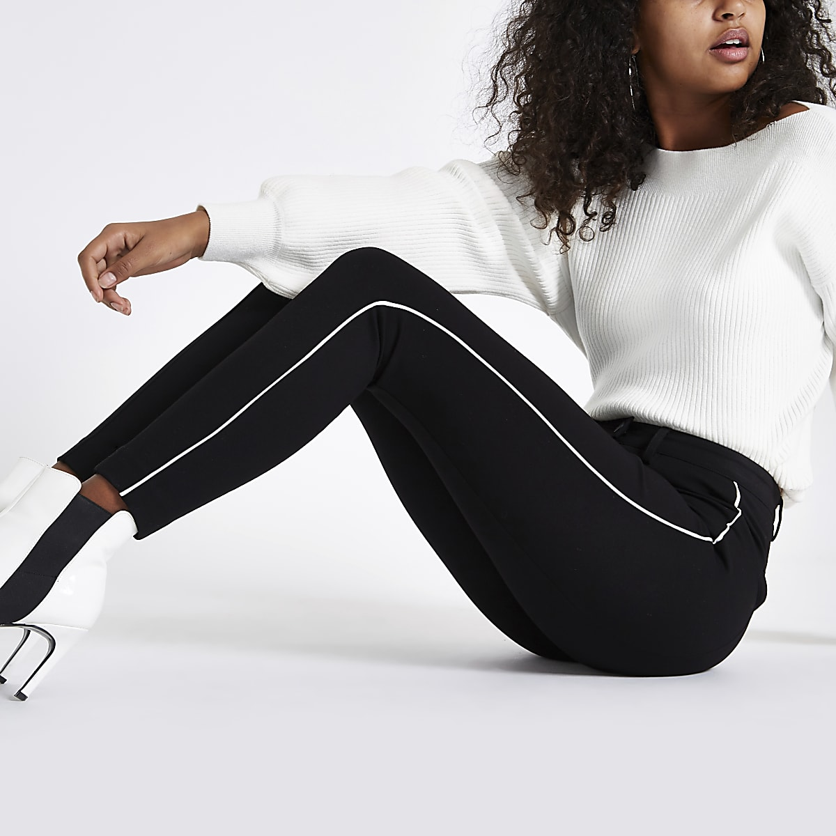 Black high waisted fitted piped trousers