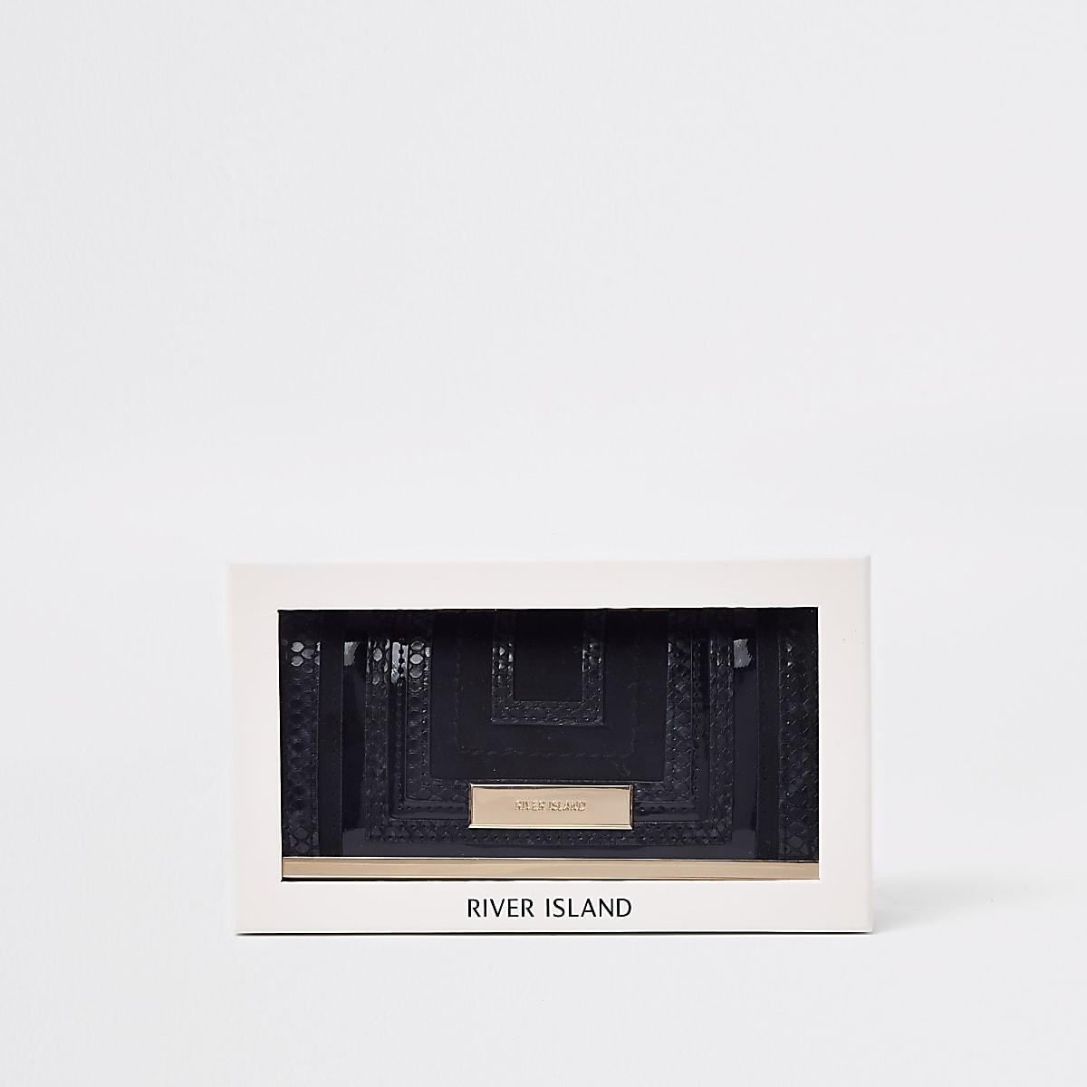 Zwarte knip met uitsnijdingen in geschenkverpakking