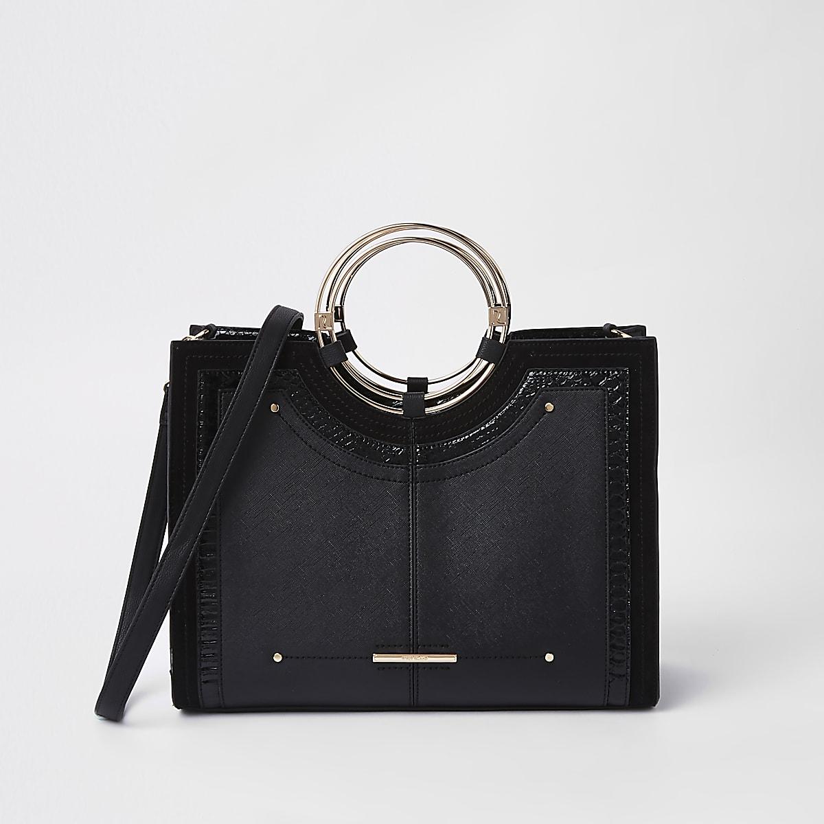 Zwarte handtas met metalen ring
