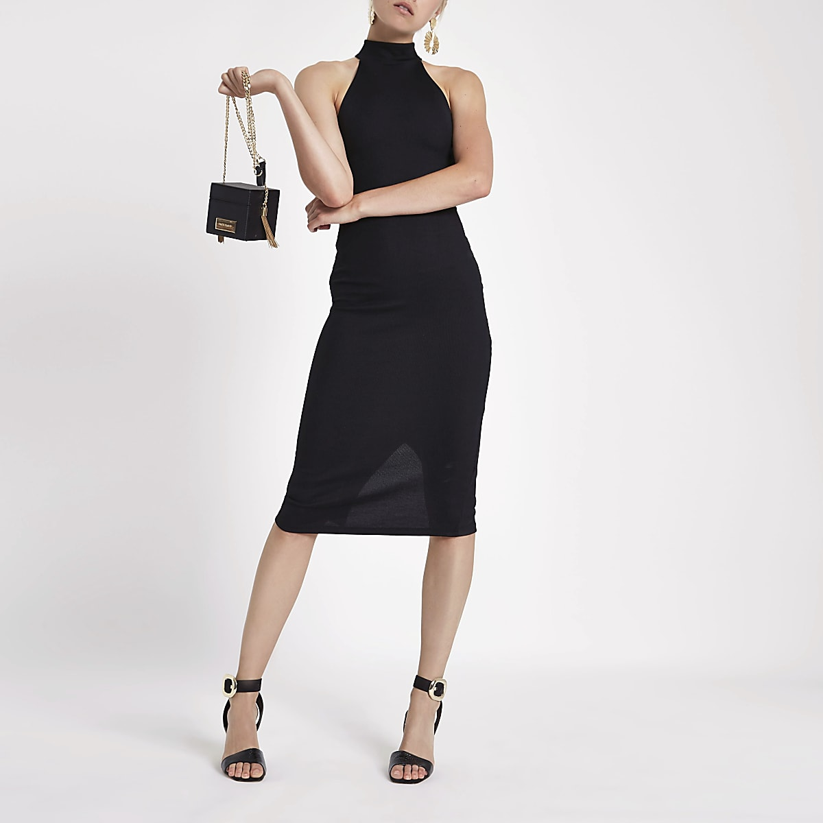 Mini-robe moulante noire à dos nu et découpes