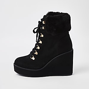 Black lace-up wedge heel boots