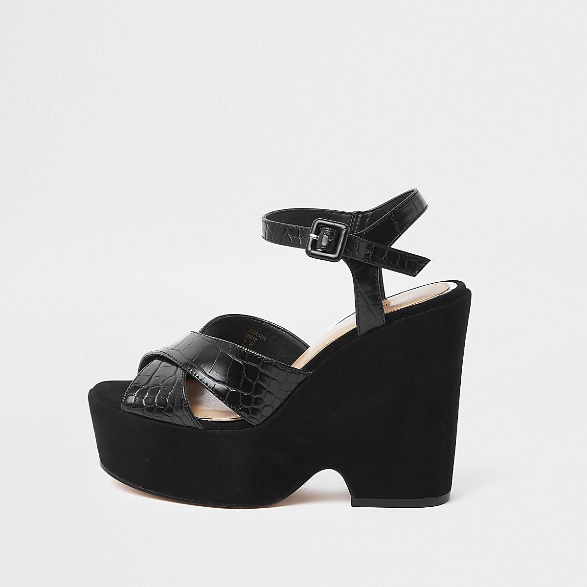 Chaussures compensées noires à brides croisées et plateforme