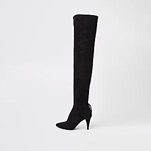 Zwarte laarzen tot over de knie met veters achter en smalle hak