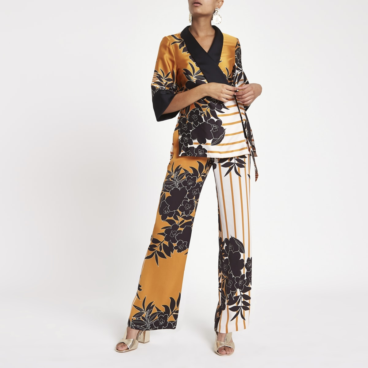 Orange floral print wide leg trousers