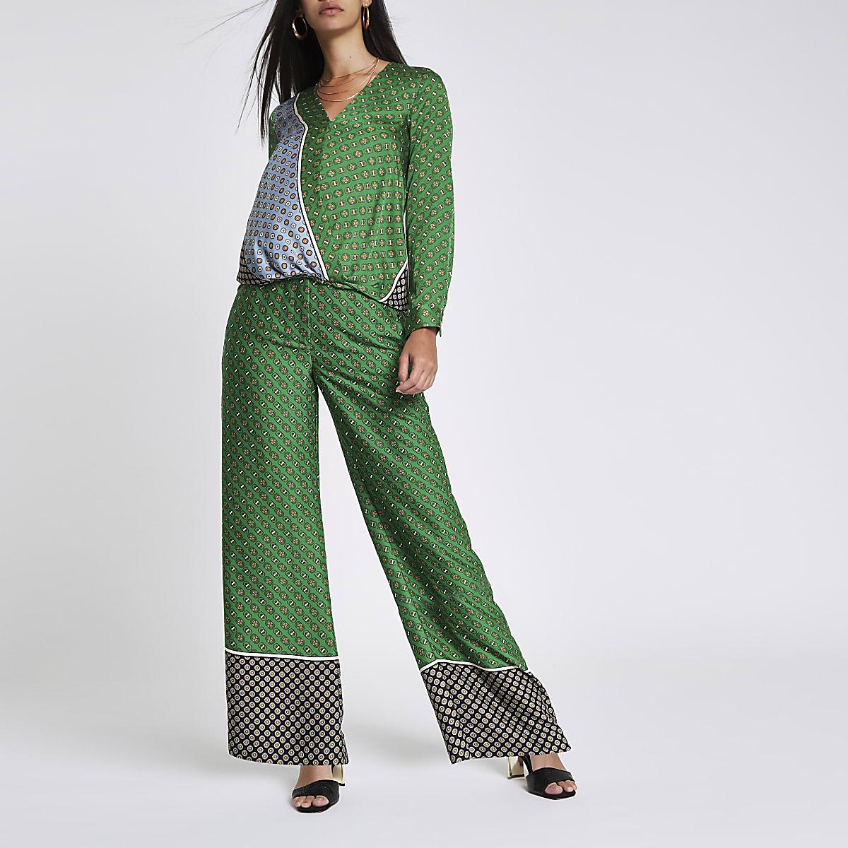 Green tile print wide leg trousers