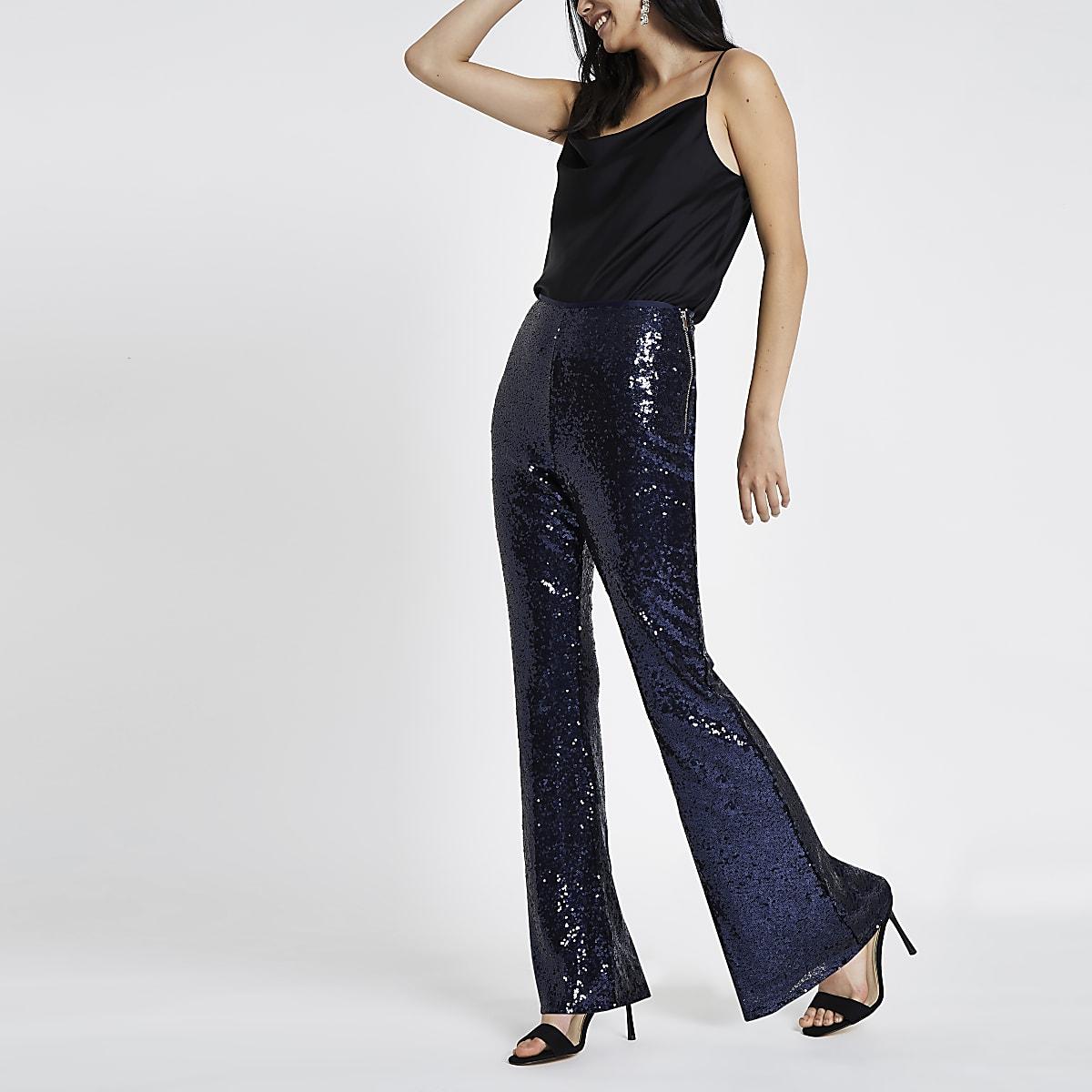 Blauwe uitlopende broek met pailletten