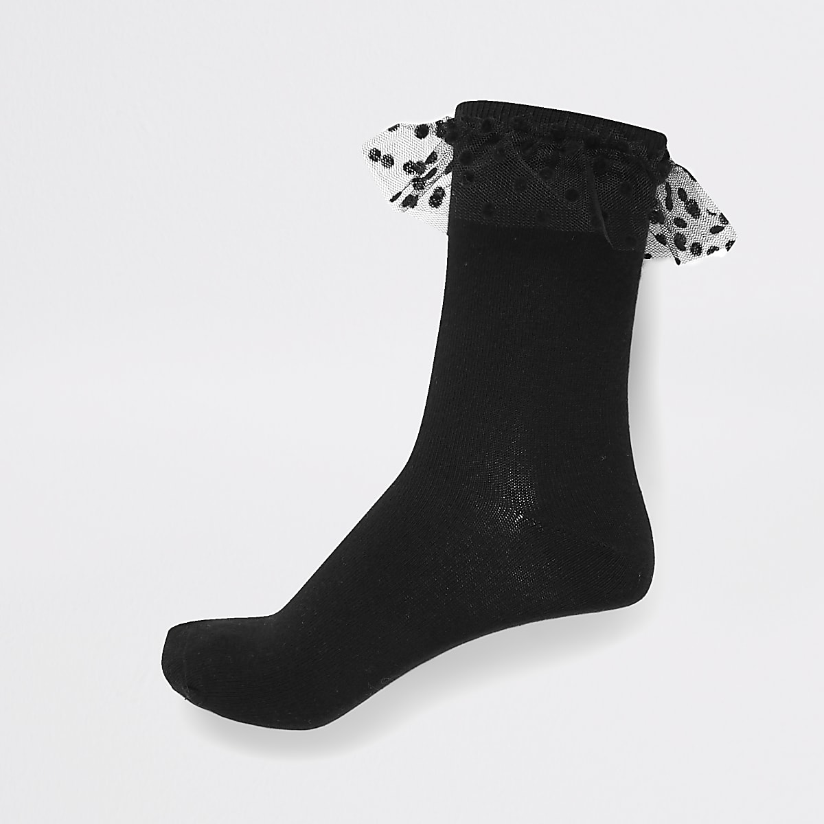 Chaussettes en maille torsadée noires avec volants en tulle à pois
