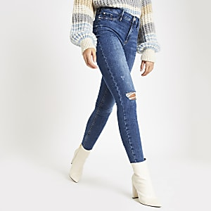 Mid blue pearl button raw hem Molly jeggings