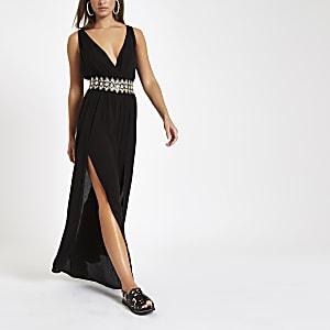 Zwarte diepuitgesnedenbeach jumpsuit met diamantjes bij de taille