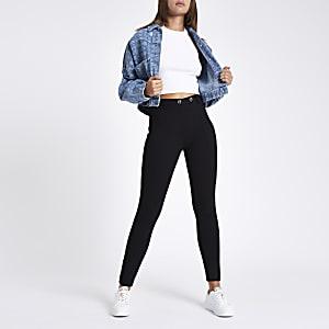 Zwarte aansluitende broek met hoge taille