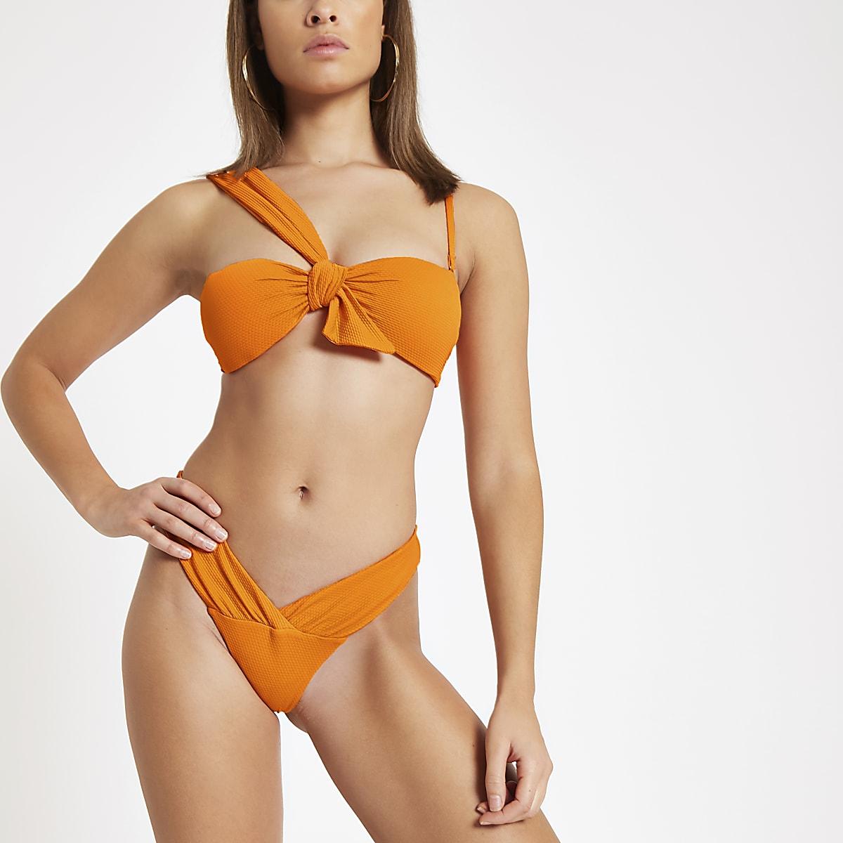 Orange textured low rise bikini bottoms