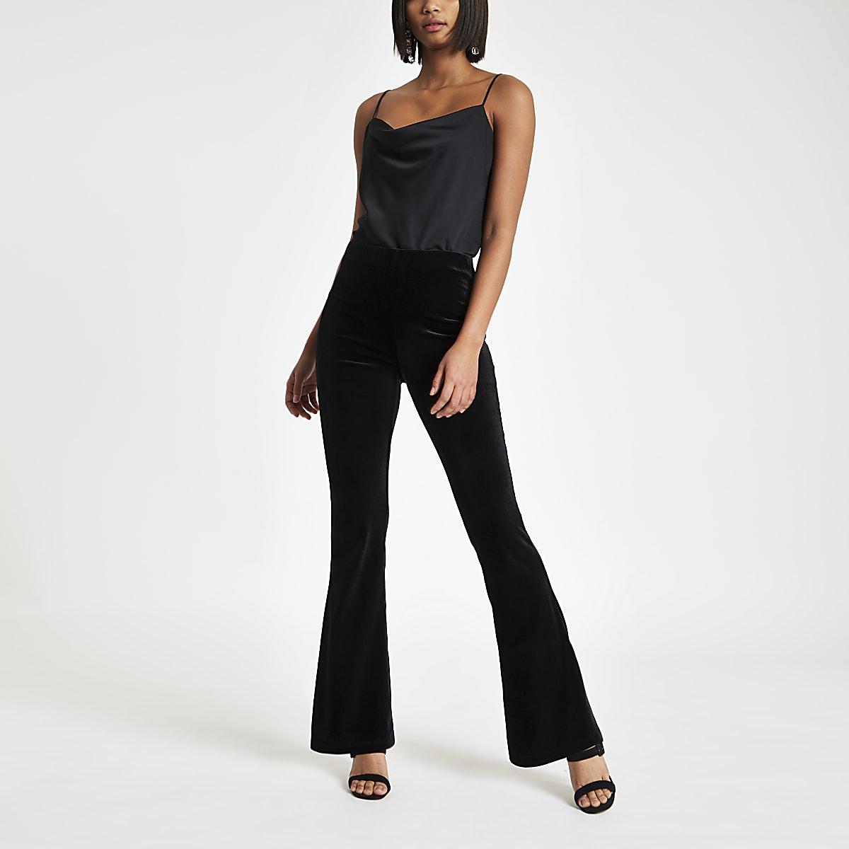 Black velvet flared trousers