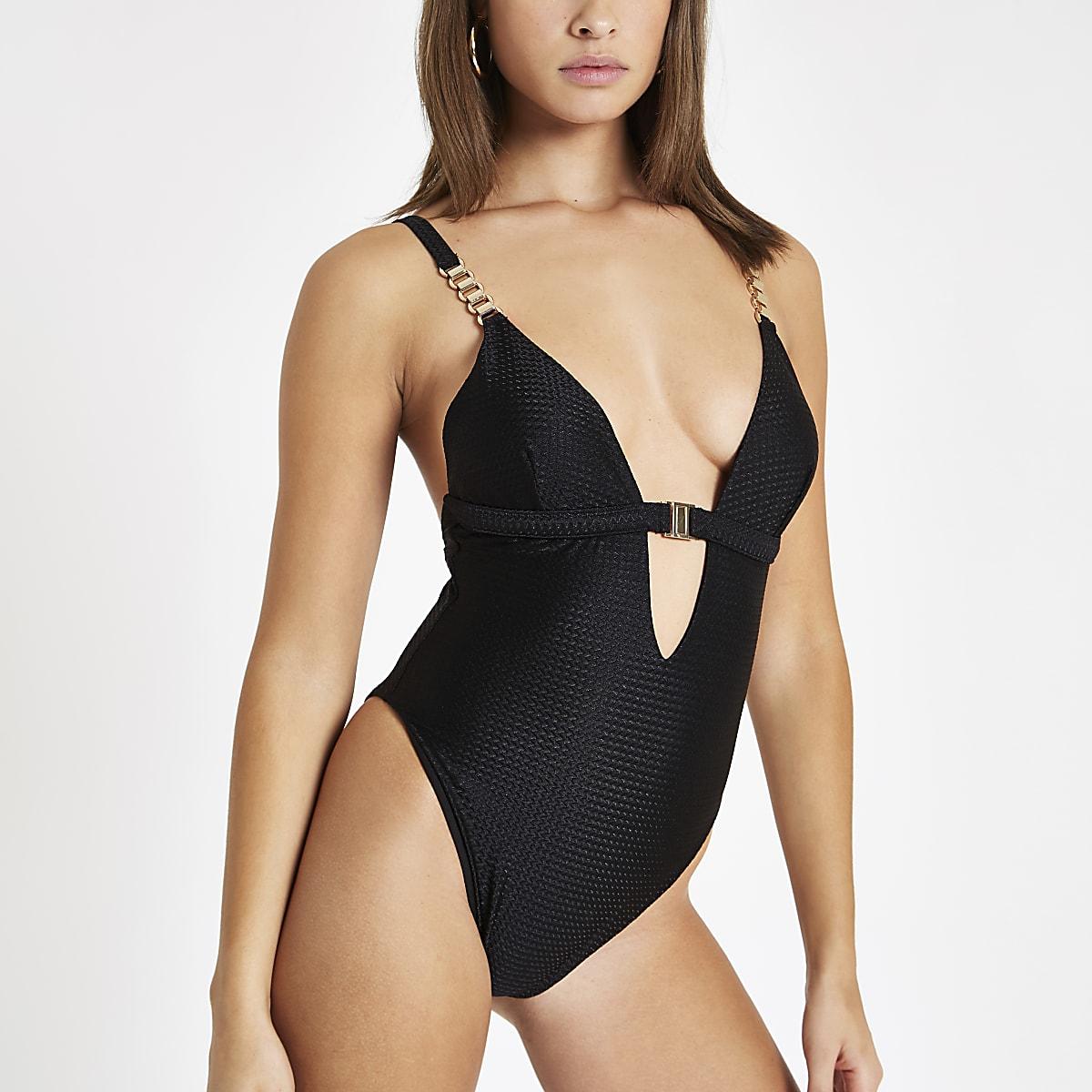Zwart zwempak met textuur en sluiting voor
