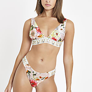Bas de bikini à fleurs rose orné