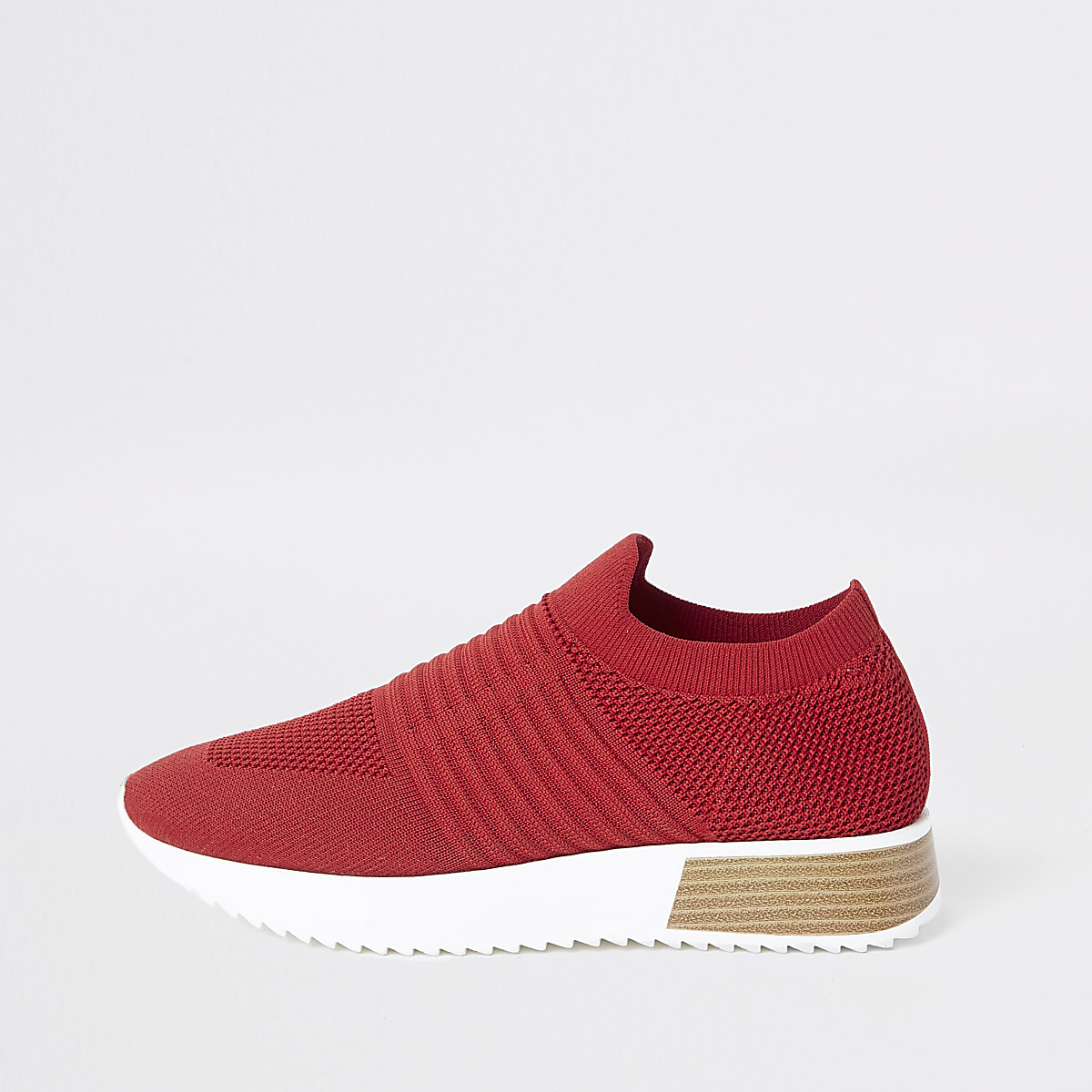 Red knitted runner trainers