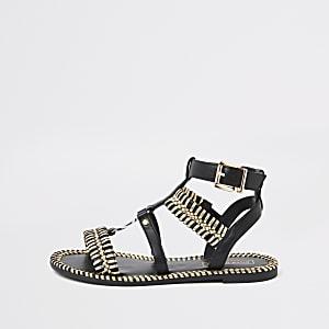 Sandales plates tressées effet cage noires