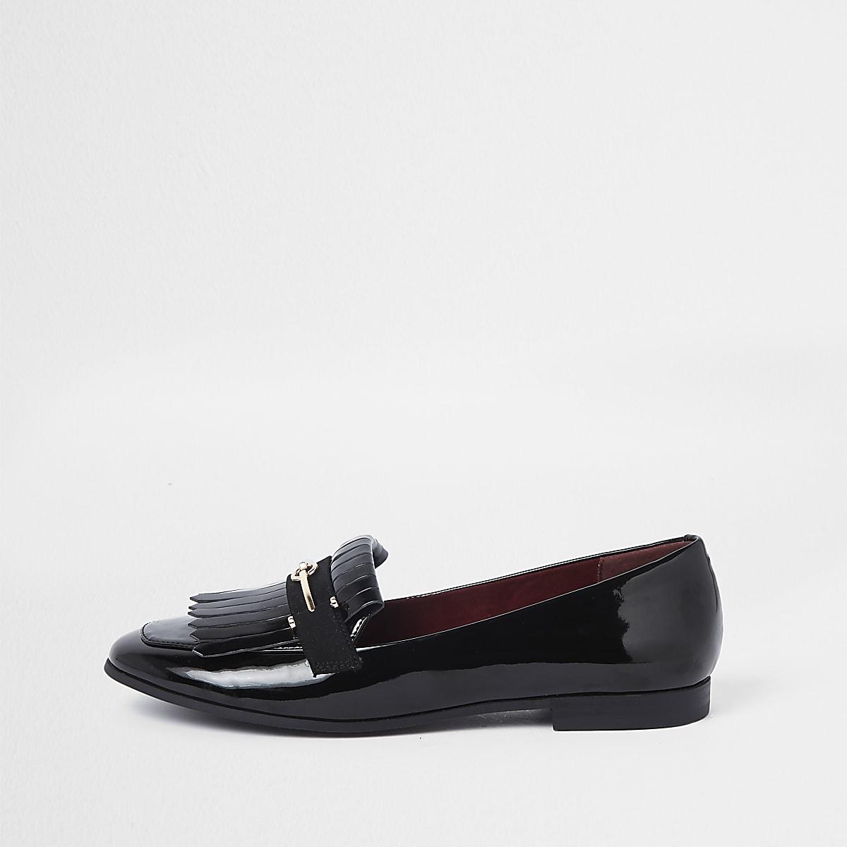 Black patent snaffle fringe loafers