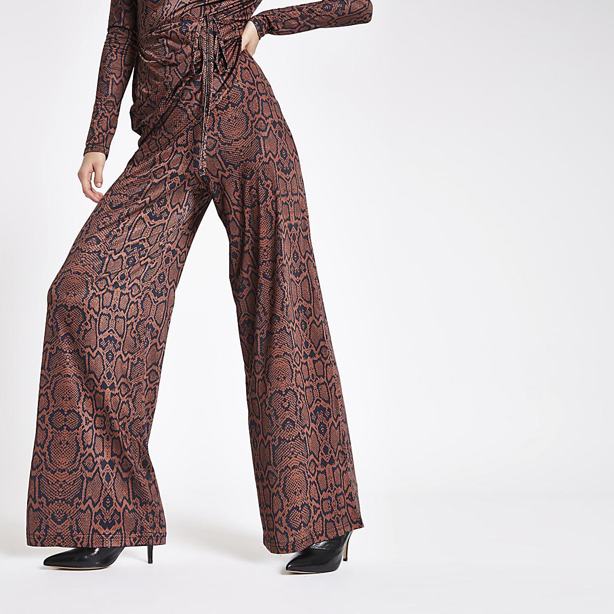 Brown snake print wide leg trousers
