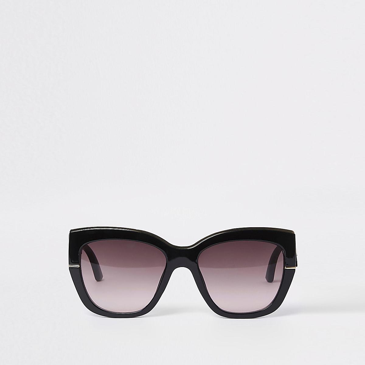 Zwarte glamour zonnebril met goudkleurige rand