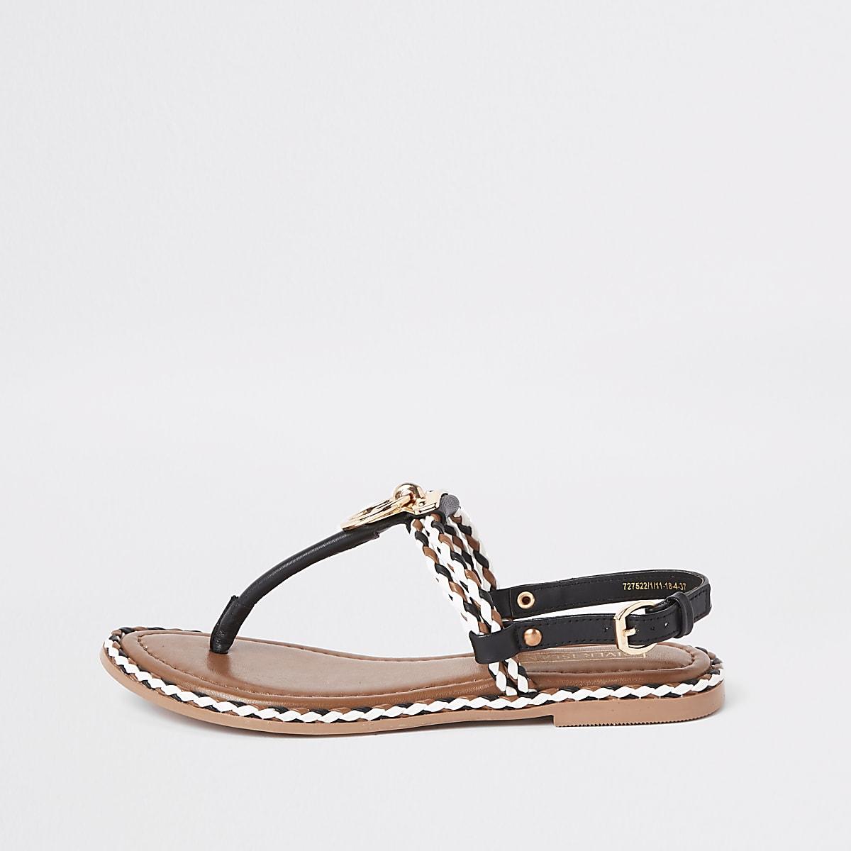 Zwarte leren platte sandalen met ring en koord