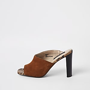 Light brown asymmetric heeled mules