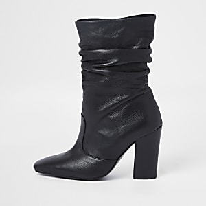 Black leather slouch boots