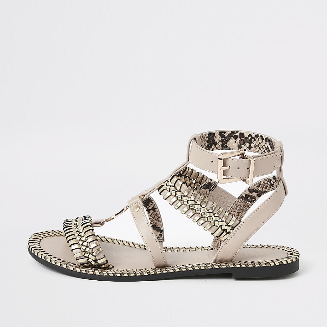 Lichtroze platte sandalen met geweven detail en bandjes