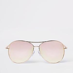 Lunettes de soleil aviateur torsadées or rose à verres effet miroir